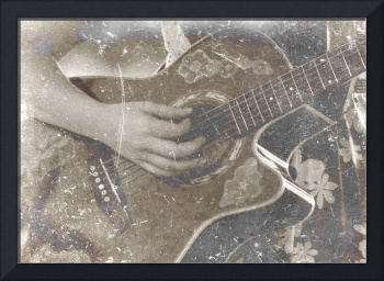 Female acoustic guitar player hand sepia grunged