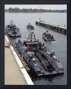 A MKV Special Operations Craft tied pierside manne