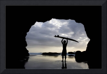 Surfer Inside A Cave At Muriwai, North Island, New