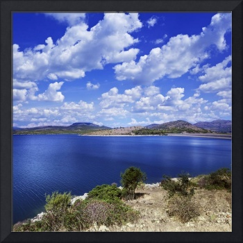 Tranquil lake against cloudy sky, Sardinia, Italy