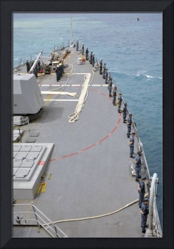Sailors man the rails on USS McCampbell
