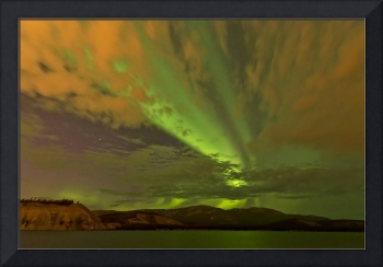 Colorful aurora borealis over lake, Yukon, Canada