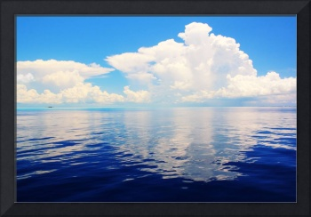 White clouds reflections on the Bahamas Sea