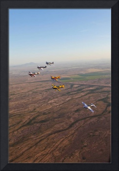 Extra 300 aerobatic aircraft fly in formation over