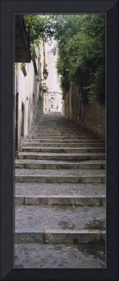 Narrow staircase to a street
