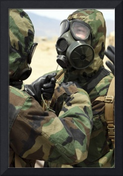 US Marine Corps reservists in camouflage and gas m