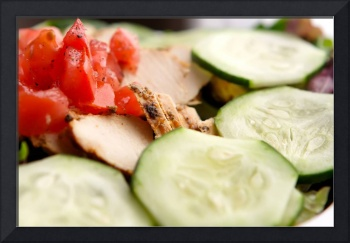 Fresh chicken salad with cucumber and chopped toma