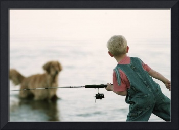 Boy Fishing With Dog