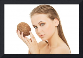 Attractive young woman with coconut. Closeup. Isol