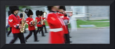Guards marching with musical instrument