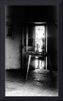 Trough The Door: A Table And No Chairs. A Lamp B&W