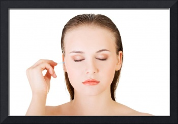 Woman face closeup while cleaning up an ear with a