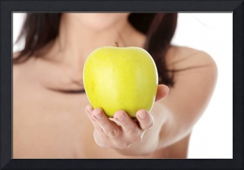 Nude young woman with a green juicy apple