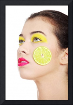 Beautiful woman's face with orange and grapefruit.