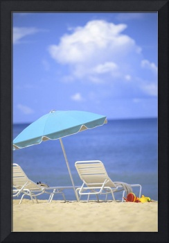 Pair Of Beach Chairs And An Umbrella On White Sand