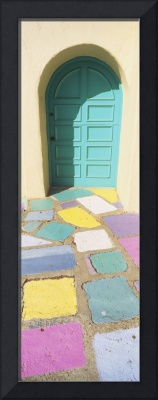 Multi-colored tiles in front of a door