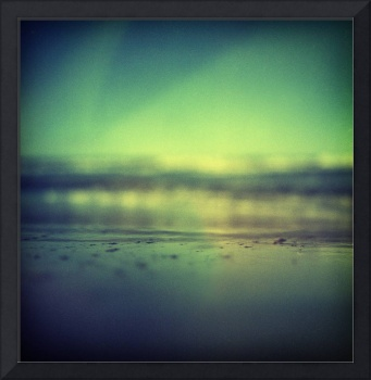Coastal shoreline in surreal green blue