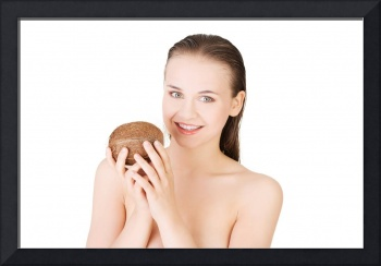 Attractive naked young woman holding a coconut. Is