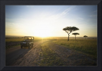 A Vehicle Drives Down A Dirt Road At Sunset Kenya