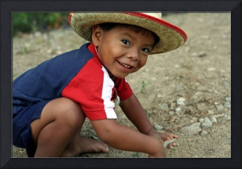 Hispanic toddler playing in the dirt