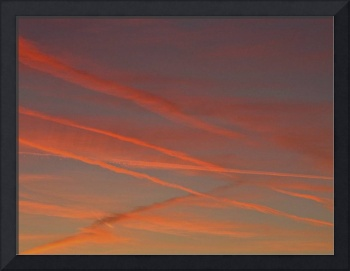 sunset with contrails
