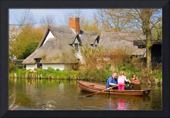 Rowing Past Thatched Cottage