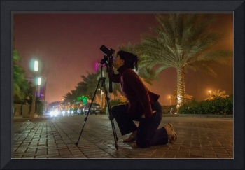 Isabela taking pictures at night time in Bahrain 2