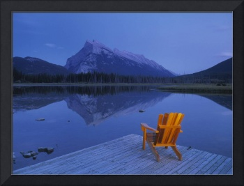 Chair On Deck Overlooking Lake And Mountain Canad