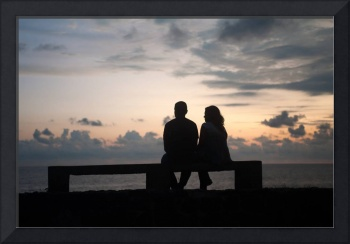 Galle Sri Lanka A young couple watch the sun set.