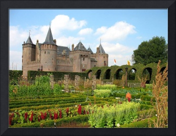 Medieval castle and vegetable gardens in summer.