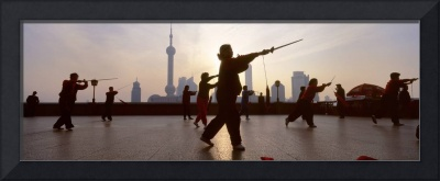 Group of people practicing Tai Chi
