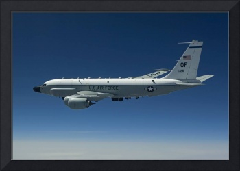 An RC-135W Rivet Joint aircraft flies over the Mid