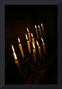 Candles lit in a dark room