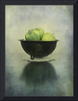 Green apples in an old enamel colander