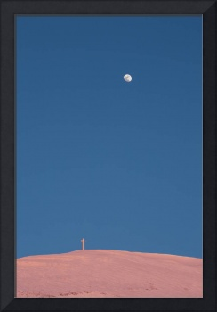 The cross of Monte Catria and the Moon at dusk