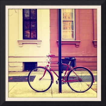 The bicycle locked up on the sidewalk shot