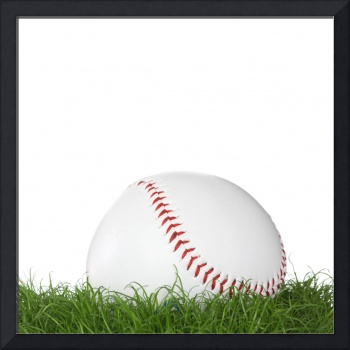 A baseball ball in the grass.