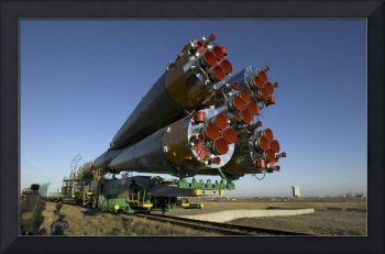 The Soyuz rocket is rolled out to the launch pad a