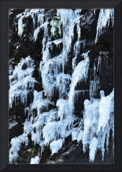 Icicles seep down a cliff in North Cascades Natl P
