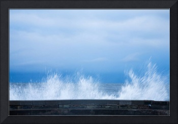 Waves crashing over seawall in Scarborough