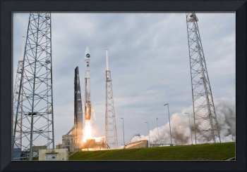 Fire and smoke signal the liftoff of the Atlas V/C