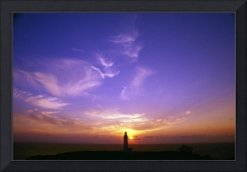 Luminous Sky Behind Distant Lighthouse