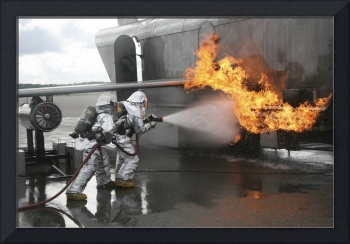 Firefighters extinguish an exterior fire during a