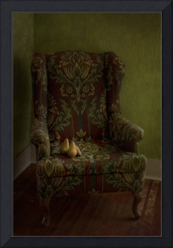 three pears sitting on a wing chair