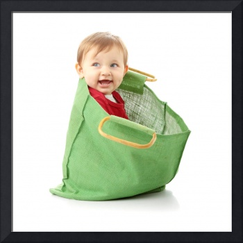 Baby girl in shopping bag