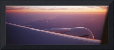Airplane wing at dusk
