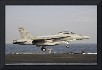 An EA-18G taking off from the flight deck of USS G
