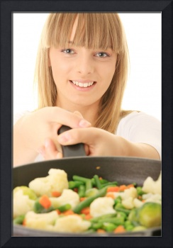Young woman cooking healthy food.