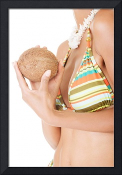 Woman holding a coconut in a colorful bikin in fro