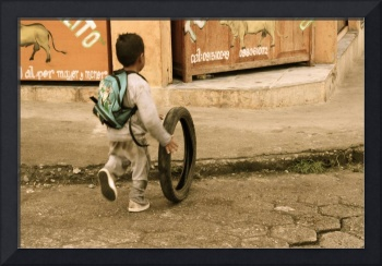 Kid pushing tire